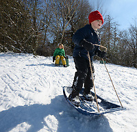 Miles Richardson (right), 7, of Fayetteville tries his hand at standing on his sled Thursday, Feb. 18, 2021, while sledding with friend Murrell Craiglow, 7, near North Street and College Avenue in Fayetteville. Visit nwaonline.com/210219Daily/ for today's photo gallery. <br /> (NWA Democrat-Gazette/Andy Shupe)