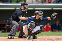 Catcher Donny Lucy #27 of the Charlotte Knights sets a target as home plate umpire Stephen Barga peers over his shoulder at Knights Stadium May 25, 2010, in Fort Mill, South Carolina.  Photo by Brian Westerholt / Four Seam Images