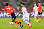 Akram Hassan Afif of Qatar (C) fights for the ball with Kim Younggwon of South Korea (L) during the AFC Asian Cup UAE 2019 Quarter Finals match between Qatar (QAT) and South Korea (KOR) at Zayed Sports City Stadium  on 25 January 2019 in Abu Dhabi, United Arab Emirates. Photo by Marcio Rodrigo Machado / Power Sport Images