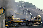 "Ireland . The Troubles, Derry Londonderry. Hijacked lorry set on fire by youths. 1980s. Lecky Road Flyover, known as ""The Flyover in the Bog""."