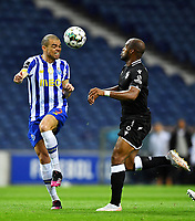 22nd April 2021; Dragao Stadium, Porto, Portugal; Portuguese Championship 2020/2021, FC Porto versus Vitoria de Guimaraes; Pepe of FC Porto and Óscar Estupiñán of Vitoria de Guimaraes challenge for a header