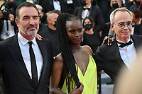 CANNES, FRANCE. July 17, 2021: Jean Dujardin, Fatou N'Diaye & Jean-Francois Halin at the Closing Gala & Awards Ceremony, and From Africa With Love Premiere at the 74th Festival de Cannes.<br /> Picture: Paul Smith / Featureflash