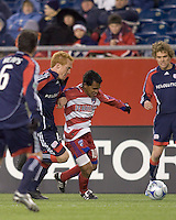 FC Dallas forward/midfielder David Ferreira (10) dribbles as New England Revolution midfielder/defender Jeff Larentowicz (13) closely defends. The New England Revolution defeated FC Dallas, 2-1, at Gillette Stadium on April 4, 2009. Photo by Andrew Katsampes /isiphotos.com