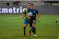 SAN JOSE, CA - OCTOBER 18: Cristian Espinoza #10 of the San Jose Earthquakes protects the ball from Shane O'Neill #27 of the Seattle Sounders during a game between Seattle Sounders FC and San Jose Earthquakes at Earthquakes Stadium on October 18, 2020 in San Jose, California.