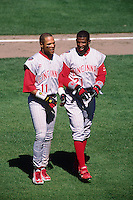 SAN FRANCISCO, CA - Deion Sanders (right) and Barry Larkin of the Cincinnati Reds in action during a game against the San Francisco Giants at Candlestick Park in San Francisco, California in 1997. Photo by Brad Mangin
