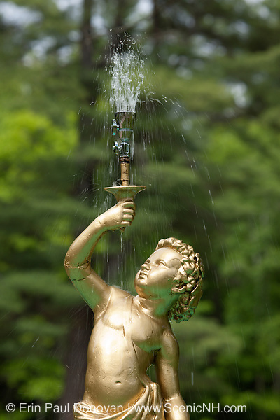 Gold statue water fountain in a New Hampshire USA cemetery