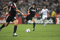 30 October,  2004.   DC United's Ben Olsen (14) shoots the ball against the MetroStars during the 2004 MLS playoffs at RFK Stadium in Washington, DC.
