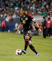 Mexico's Giovani dos Santos dribbles the ball.  Mexico defeated Costa Rica 4-1 at the 2011 CONCACAF Gold Cup at Soldier Field in Chicago, IL on June 12, 2011.