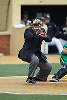 Home plate umpire Gregory Street makes a strike call during the ACC baseball game between the Notre Dame Fighting Irish and the Wake Forest Demon Deacons at David F. Couch Ballpark on March 10, 2019 in  Winston-Salem, North Carolina. The Demon Deacons defeated the Fighting Irish 7-4 in game one of a double-header.  (Brian Westerholt/Four Seam Images)