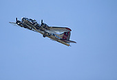 A B17 flies over in honor of Connie Kalitta Sunday.