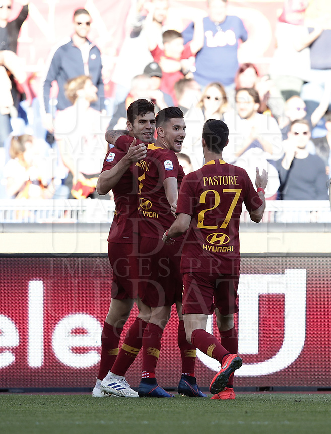 Football, Serie A: AS Roma - Cagliari, Olympic stadium, Rome, April 27, 2019. <br /> Roma's Federico Fazio (l) celebrates after scoring with his teammates Lorenzo Pellegrini (c) and Javier Pastore (r) during the Italian Serie A football match between AS Roma and Cagliari, on April 27, 2019. <br /> UPDATE IMAGES PRESS/Isabella Bonotto