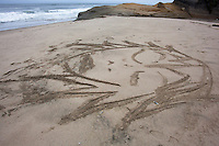 Previous visitors have left a bit of art at Pomponio State Beach, CA.