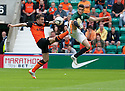 Dundee Utd's Paul Paton and Hib's Alex Harris challenge for the ball.