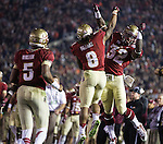 Devonta Freeman (L) and James Wilder Jr celebrate FSU's first touchdown by Freeman during the BCS national title game at the Rose Bowl in Pasadena, California on January 6, 2014.   The Florida State Seminoles defeated the Auburn Tiger 34-31 to win the final BCS National Championship.