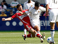 Chicago Fire defender Gonzalo Segares (25) slide tackles the ball away from Real Salt Lake forward Alecko Eskandarian (9).  The Chicago Fire and Real Salt Lake tied 0-0 at Toyota Park in Bridgeview, IL on May 27, 2007.