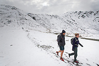 Cori Schleich and Max Zentner return from a short walk through freshly fallen snow on April Bowl Trail near the top of Hatcher Pass. The road over the pass is closed to vehicle traffic for winter starting Sept. 14 this year.