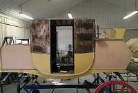 BNPS.co.uk (01202 558833)<br /> Pic: MarkBroadbent/BNPS<br /> <br /> Work in progress.<br /> <br /> Last Post - Britain's last Royal Mail carriage, that bizarrely once survived an attack by a lion outside Salisbury, has been saved for the nation.<br /> <br /> The 200-year-old horse-drawn carriage harks back to the golden age of the Royal Mail when crowds gathered along the route to see the lightning-quick service thunder by.<br /> <br /> The restored four horse coach was known as 'Quicksilver' as it was the fastest in the land on its regular 21 hour run from Devonport, Devon, to London.<br /> <br /> But the red and black wooden wagon went down in history for an extraordinary incident involving a lion in the English countryside in 1816.