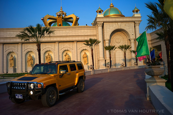 A yellow Hummer pulls out of the King's Roman Casino in Tonpheung, inside the Golden Triangle Chinese Special Economic Zone in Laos on March 10, 2011.