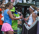 March 31 2016: Timea Bacsinszky (SUI), on right, congratulates Svetlana Kuznetsova (RUS) at the Miami Open being played at Crandon Park Tennis Center in Miami, Key Biscayne, Florida.
