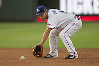 Round Rock Express second baseman Kensuke Tanaka (8) fields a ground ball during the Pacific Coast League baseball game against the Fresno Grizzlies on June 22, 2014 at the Dell Diamond in Round Rock, Texas. The Express defeated the Grizzlies 2-1. (Andrew Woolley/Four Seam Images)
