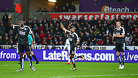 Riyad Mahrez of Leicester City celebrates scoring his goal to make the score 0-1 during the Barclays Premier League match between Swansea City and Leicester City played at The Liberty Stadium on 5th December 2015