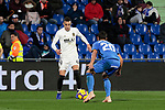 Getafe CF's Nemanja Maksimovic and Valencia CF's Rodrigo Moreno during La Liga match between Getafe CF and Valencia CF at Coliseum Alfonso Perez in Getafe, Spain. November 10, 2018.