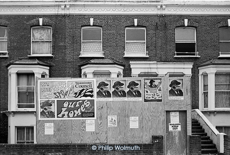 Posters designed by Paddington Printshop/London Print Studio on Walterton Estate houses left empty and intended for sale to property developers by Westminster City Council. North Paddington, 1986.