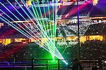 Lasers light up the bull riding arena during the Professional Bull Riders, Iron Cowboy V bull riding event, at the AT & T stadium in Arlington, Texas.