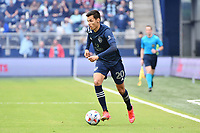 KANSAS CITY, KS - MAY 16: Daniel Salloi #20 Sporting KC with the ball during a game between Vancouver Whitecaps and Sporting Kansas City at Children's Mercy Park on May 16, 2021 in Kansas City, Kansas.