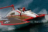"David Williams, U-1 ""Miss Budweiser"" (1980 Rolls-Royce Griffon powered Ron Joes hull) waves to the crowd."