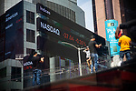 Nasdaq index information is displayed on monitors in front of Morgan Stanley in New York on Wednesday, April 14, 2021. Photographer: Michael Nagle