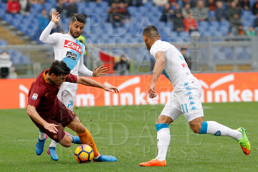 Roma's Diego Perotti, left, is chased by Napoli's Lorenzo Insigne, center, and Faouzi Ghoulam during the Italian Serie A football match between Roma and Napoli at Rome's Olympic stadium, 4 March 2017. <br /> UPDATE IMAGES PRESS/Riccardo De Luca