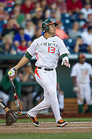 Miami Hurricanes outfielder Willie Abreu (13) follows through on his swing during the NCAA College baseball World Series against the Arkansas Razorbacks  on June 15, 2015 at TD Ameritrade Park in Omaha, Nebraska. Miami beat Arkansas 4-3. (Andrew Woolley/Four Seam Images)
