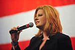 Lee Marshall sings National Anthem at Veterans Day Dinner 2010.  Bob Gathany photo.