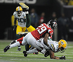 Green Bay Packers tight end Andrew Quarless finishes off a first down catch with 4:07 left in the fourth quarter near Atlanta Falcons' Brian Williams at the Georgia Dome in Atlanta, Ga., on Nov. 28, 2010.