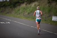 Mirinda Carfrae on a blistering pace on the run at the 2013 Ironman World Championship in Kailua-Kona, Hawaii on October 12, 2013.