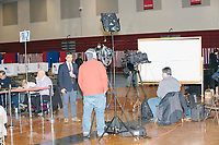 A news crew works as voters place votes in the New Hampshire Presidential Primary at Bedford High School in Bedford, New Hampshire, on Tue., Feb. 11, 2020.