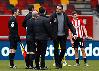 14th February 2021; Brentford Community Stadium, London, England; English Football League Championship Football, Brentford FC versus Barnsley; Barnsley Manager Valerien Ismael shakes hands with Referee David Coote after the final whistle
