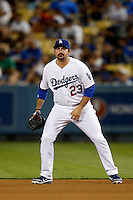 Adrian Gonzalez #23 of the Los Angeles Dodgers in the field at first base during a game against the Colorado Rockies at Dodger Stadium on September 29, 2012 in Los Angeles, California. Los Angeles defeated Colorado 3-0. (Larry Goren/Four Seam Images)