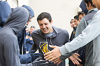 BERKELEY, CA - Feb. 18, 2017:Cal's Long Gutierrez high-fives his teammates while being introduced on Senior Day. Cal Men's Swimming and Diving competed against Stanford at Spieker Aquatics Complex.