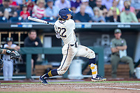 Michigan Wolverines outfielder Jordan Brewer (22) follows through on his swing against the Vanderbilt Commodores during Game 1 of the NCAA College World Series Finals on June 24, 2019 at TD Ameritrade Park in Omaha, Nebraska. Michigan defeated Vanderbilt 7-4. (Andrew Woolley/Four Seam Images)