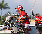 WELLINGTON, FL - FEBRUARY 19: Gillian Johnston of Coca Cola scores the tying goal in the sixth chukker, as Wes Finlayson celebrates.  Coca Cola 9 defeats Tonkawa 8 in overtime with a Golden Goal on a Penalty 2 by Julio Arellano, in the William Ylvisaker Cup Final, at the International Polo Club, Palm Beach on February 19, 2017 in Wellington, Florida. (Photo by Liz Lamont/Eclipse Sportswire/Getty Images)