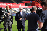 (L-R) Thierry Henry and Alan Pardew are interviewed by a television crew during the English Premier League soccer match between Swansea City and Manchester United at Liberty Stadium, Swansea, Wales, UK. Saturday 18 August 2017