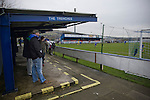 Glossop North End 0 Barnoldswick Town 1, 19/02/2011. Surrey Street, North West Counties League Premier Division. Glossop North End supporters standing in an enclosure known as The Trenches at the club's Surrey Street ground watching as their club play Barnoldswick Town (in yellow) in the Vodkat North West Counties League premier division. The visitors won the match by one goal to nil watched by a crowd of 203 spectators. Glossop North End celebrated their 125th anniversary in 2011 and were once members of the Football League in England, spending one season in the top division in 1899-00. Photo by Colin McPherson.