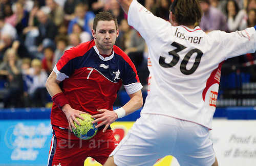 08 JAN 2012 - LONDON, GBR - Great Britain playmaker Chris Mohr (#7, in red) looks for a way past Austria's Andreas Lassner (#30, in white) during the men's 2013 World Handball Championships qualification match at the National Sports Centre in Crystal Palace, Great Britain (PHOTO (C) 2012 NIGEL FARROW)