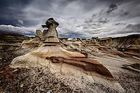 Hoodoos and sandstone formations under a winter sky at the Bisti Widerness in New Mexico's San Juan Basin.