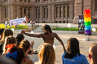 AUSTIN, TEXAS - A performer shakes hands with the crowd on the South steps of the Texas State Capitol on Saturday, Aug. 23, 2016 for the 6th Annual Stonewall Rally in observance of the 46th anniversary of the Stonewall Riots.<br /> <br /> Use of this image in advertising or for promotional purposes is prohibited.<br /> <br /> Editorial Credit: Photo by Dan Herron / Herron Stock