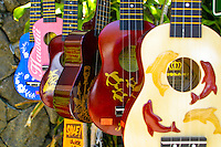 Ukulele's are a symbol of Hawaiian style music. Here they are available in assorted colors as functional keepsakes for shopping tourists.