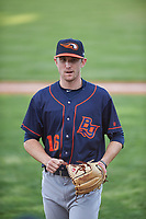 Bowling Green Hot Rods relief pitcher Alan Strong (16) walks off the field between innings a Midwest League game against the Peoria Chiefs at Dozer Park on May 5, 2019 in Peoria, Illinois. Peoria defeated Bowling Green 11-3. (Zachary Lucy/Four Seam Images)