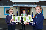 Faha NS pupils l-r: Elsa Daly right with Conor McKeon and Abbie Fleming with their book Trouble In The Alleyway which their class made and extracts from the book were published in The Irish Times on Tuesday